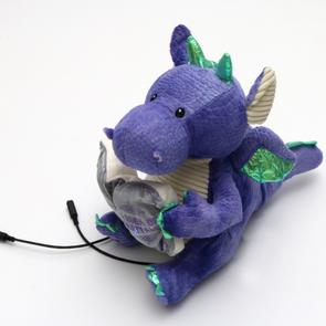 Small image of the toy dragon with a book.
