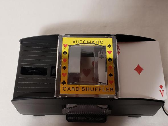 Small image of card shuffling device.