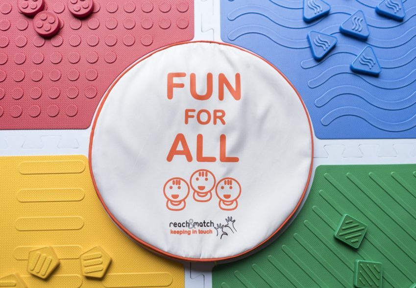 Four mats and central cushion labeled Fun for All.